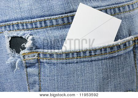 Blank card in back pocket of torn jeans