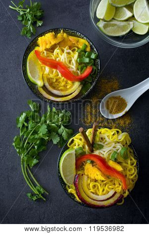 Thai noodles and curry on slate