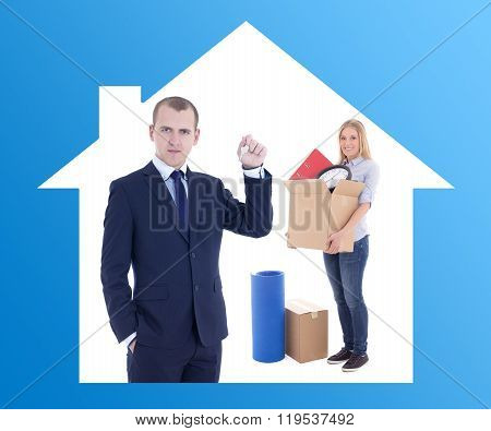 Moving Day Concept - Businessman Real Estate Agent Giving Key To Woman With Cardboard Boxes