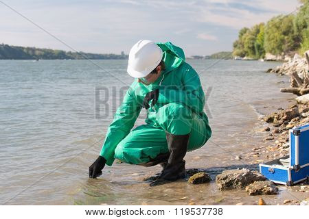 Water Quality Inspector Filling Up Sample Container