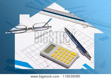 Business And Real Estate - Graphs, Charts, Pen And Calculator In Blue House Frame