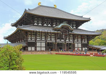 NARA, JAPAN - APRIL 2015 : People visiting Great Buddha Hall (daibutsuden) at Todai-ji Temple in Nara, Japan on April 21, 2015. It is a Buddhist temple complex listed as UNESCO World Heritage Site