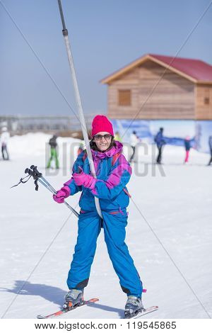 Portrait Of Female Skier On Stirrup