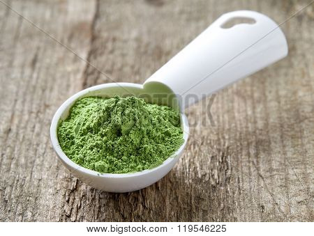 Measuring Scoop Of Barley Or Wheat Grass Powder