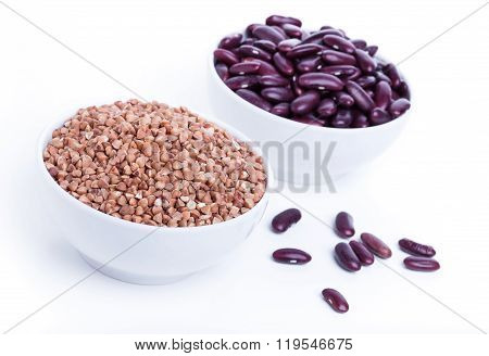 Dry Buckwheat And Black Beans In White Bowl