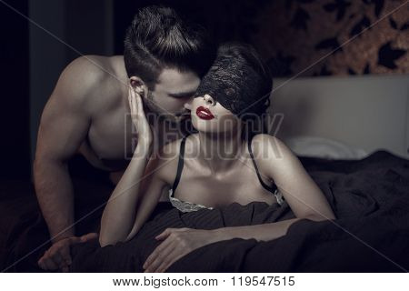 Sexy Woman In Lace Eye Cover And Red Lips With Young Lover