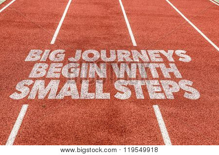 Big Journeys Begin With Small Steps written on running track