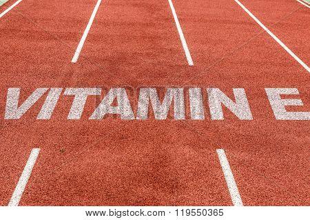 Vitamin E written on running track