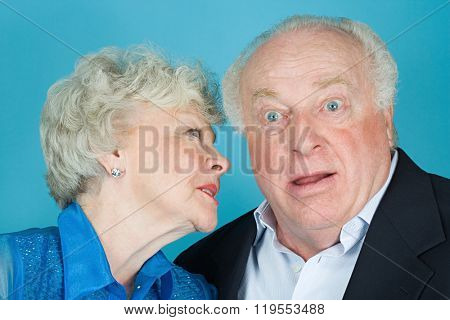 Woman whispering to husband