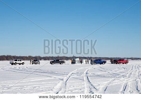 Fishermen Gathering On A Frozen Lake