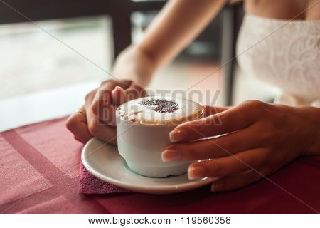 Bride Holding Cup Of Coffee