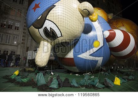 NEW YORK - NOV 25 2015: Arrtle The Pirate balloon tied down with sandbags and netting during Macy's Giant Balloon Inflation event held the day before Thanksgiving in Manhattan.