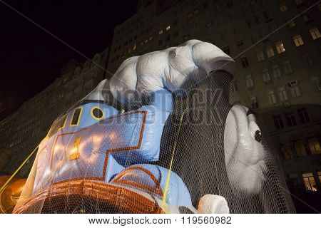 NEW YORK - NOV 25 2015: Mattels steam engine character Thomas The Tank Engine balloon tied down with sandbags and netting during Macy's Giant Balloon Inflation event the day before Thanksgiving.