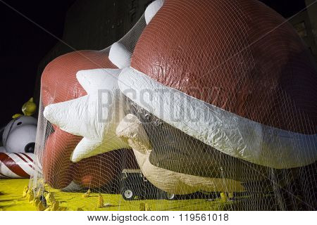 NEW YORK - NOV 25 2015: The Elf On The Shelf balloon dressed in red and white tied down with sandbags and netting during Macy's Giant Balloon Inflation event held the day before Thanksgiving.