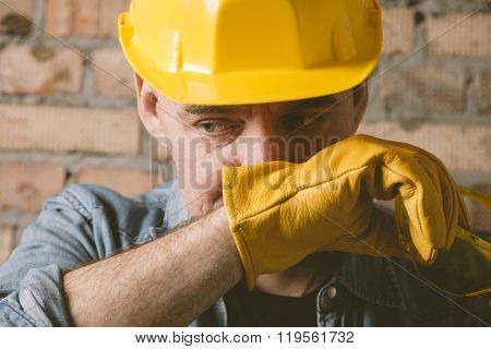 portrait of construction worker with yellow hat