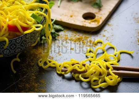 Noodles with curry on slate