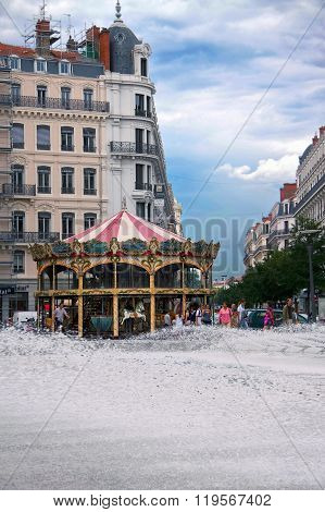 LYON FRANCE - JULY 21 2010: Citylife in Lyon, fountain and carousel in historical downtown.