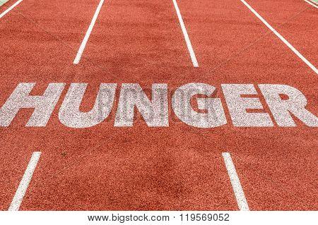 Hunger written on running track