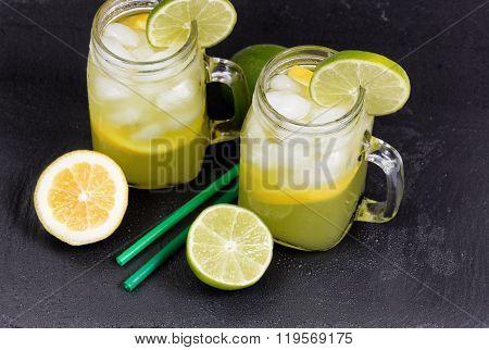 Homemade Lemonade In Jar Glasses On Black Natural Slate Stone Background