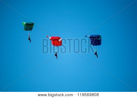Sport Skydivers Perform During The Figure Jumps