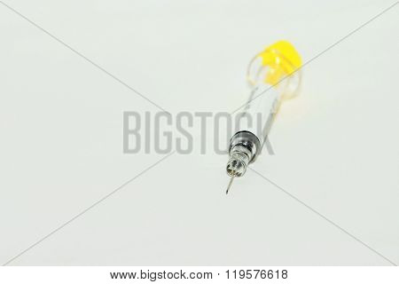 Syringe on white background
