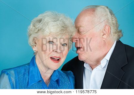 Man whispering to wife