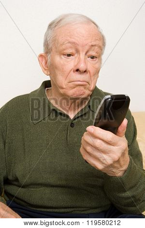 Elderly man with remote control