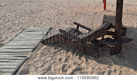 Wooden chaise lounge on the beach. Furniture for a beach holiday.