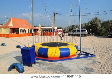 Russia Achuevo - August 2 2015: Swing with a trampoline at the beach.