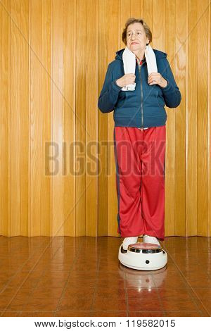 Senior woman stood on scales