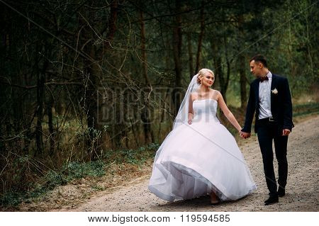 Bride And Groom At Wedding Day Hugging Outdoors On Spring Nature. Bridal Couple, Happy Newlywed Woma