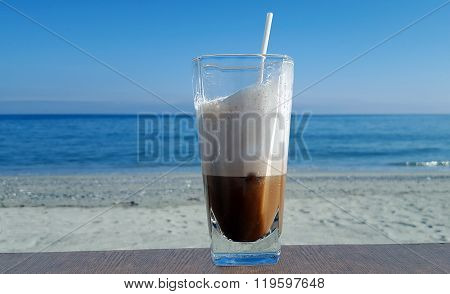 Iced Coffee On Table Beside The Seaside