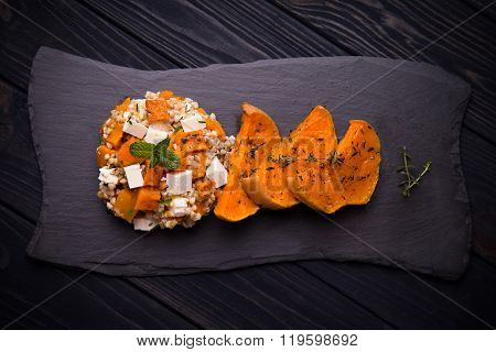 Baked pumpkin salad with green buckwheat and feta cheese