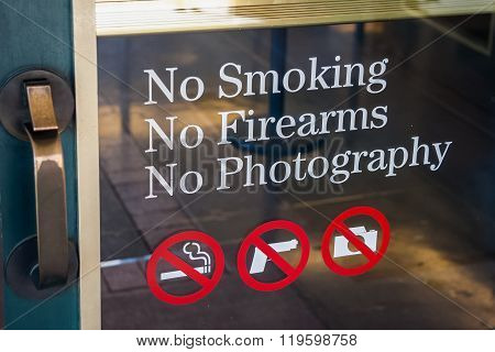 No Smoking, No Firearms, No Photography Sign At The Door  Entrance