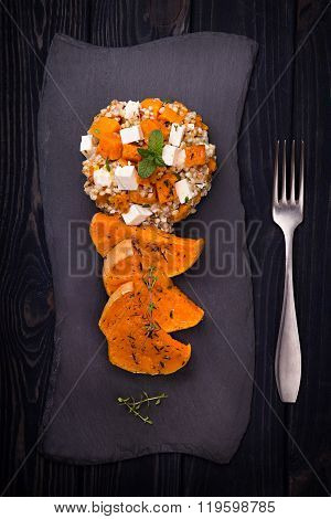 Salad with baked squash, green buckwheat and feta cheese