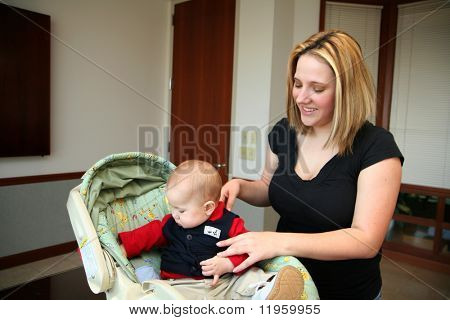A mother with her son inside their home