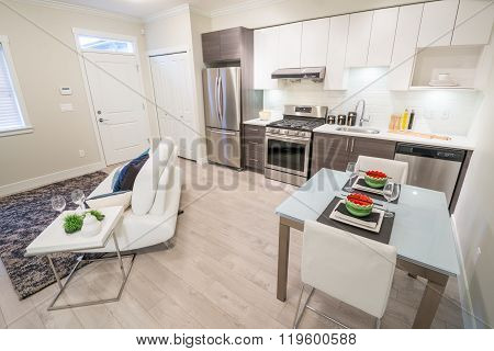 Bright living room with sofa and kitchen with dinner table. Interior design