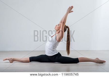 Beautiful young woman is doing the exercise