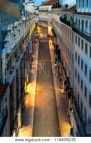 Rua Do Carmo Street At Night, City Of Lisbon, Portugal.