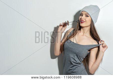 Cheerful slim woman is seducing with desire