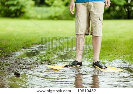 Standing In Puddle With Flippers