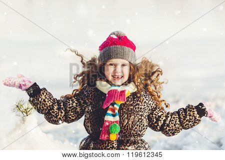 Funny Girl Up Her Hand, And Catches Falling Snowflakes. Happy Childhood And Healthy Concept.