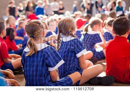 Aussie school kids sitting together , learning