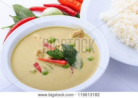 Thai traditional and popular food, Thai chicken green curry intense soup on brown cloth background.