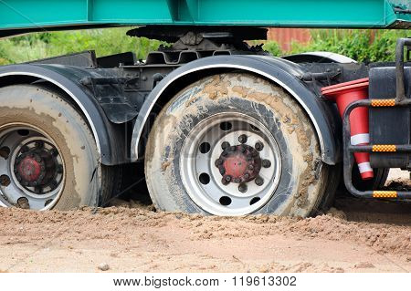 truck mired deeply in the mud, closeup truck's tires