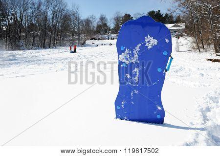 kids snow board against ski park