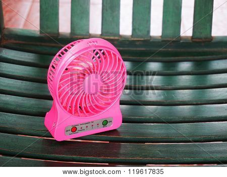Portable Fan Usb On The Wood Chair