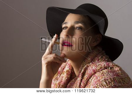 Mature Woman With Black Hat Sit Smoking