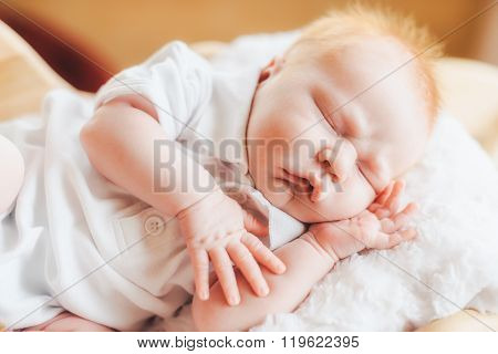 Newborn baby boy with pajamas sleeping in basket
