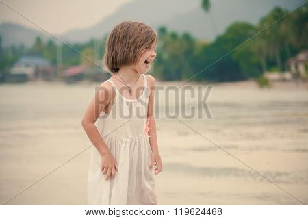 Young Happy Girl In White Dress